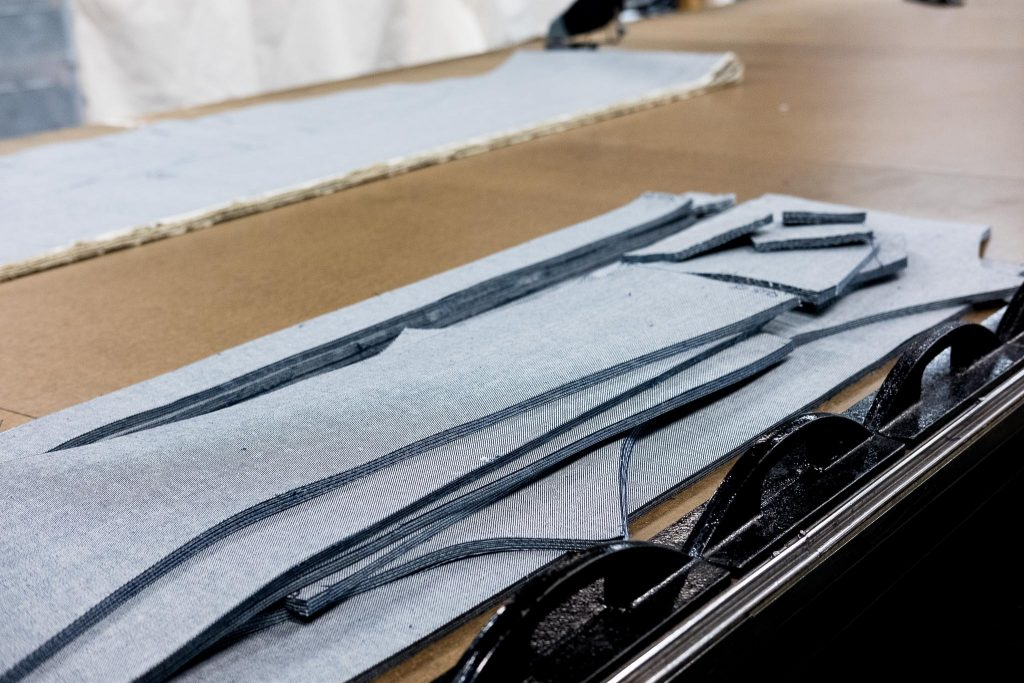 Shockoe Atelier cutting room floor with cut denim.