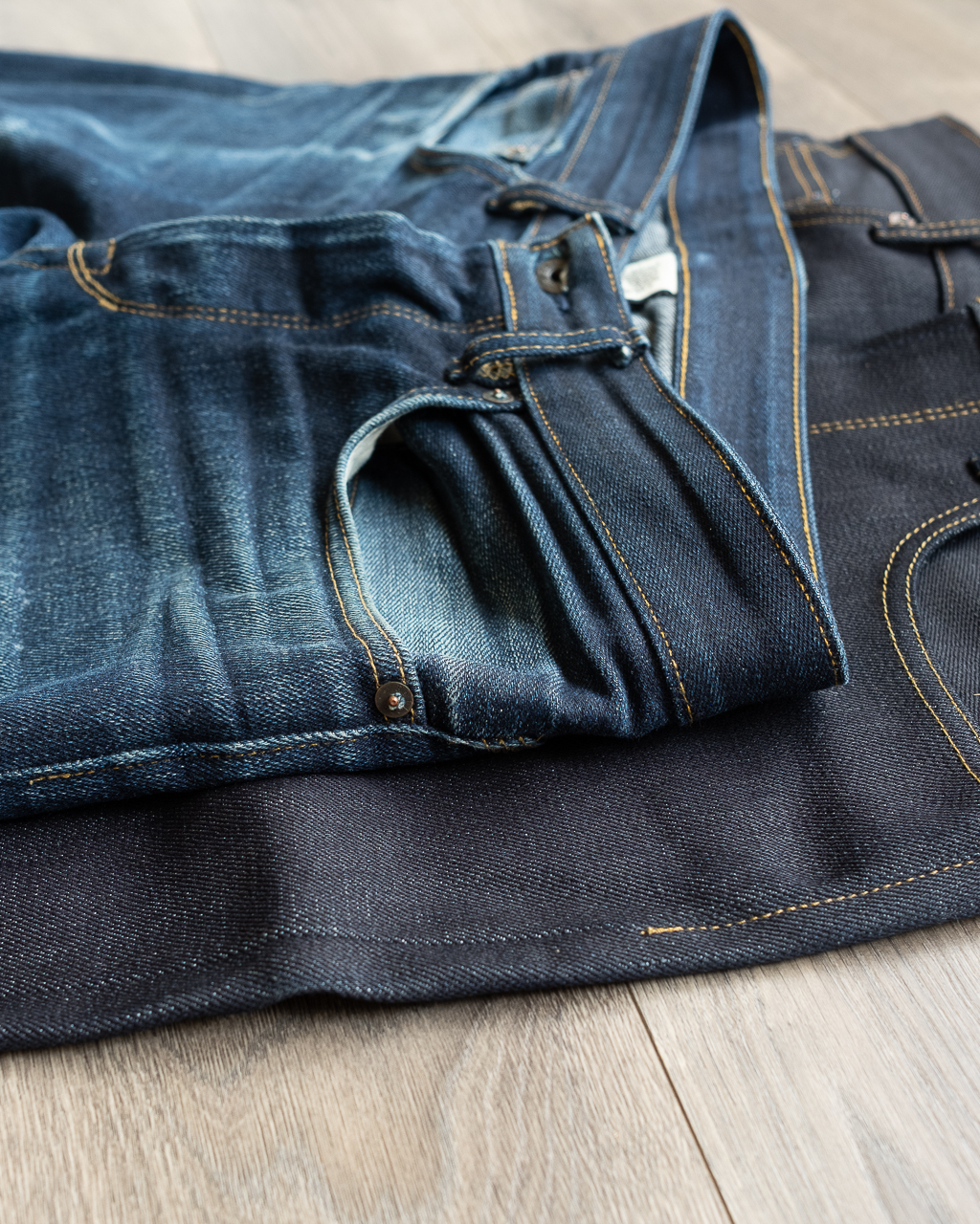 fade comparison between new railcar fine goods x034 denim and two year old pair