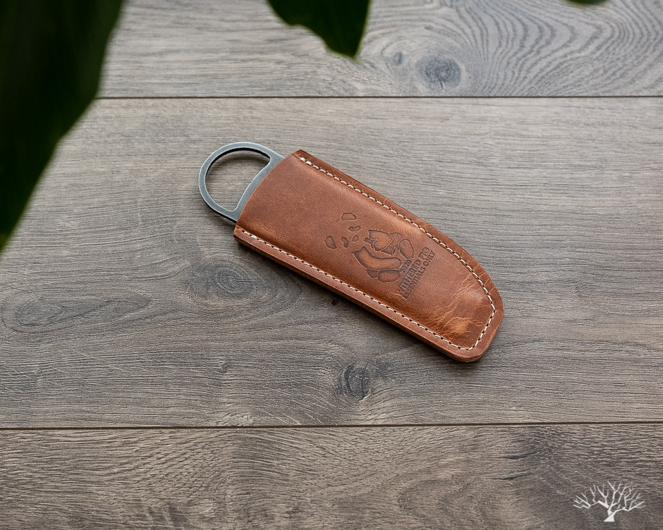 high side x withered fig wax cutter and bottle opener with horween natural dublin leather sheath